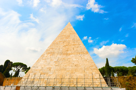 The Pyramid of Cestius is an ancient pyramid in Rome, Italy. The pyramid was built about 18 BCE–12 BCE as a tomb for Gaius Cestius, a magistrate and member. It is of brick-faced concrete covered with slabs of white marble standing on a travertine founda