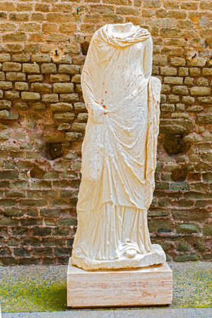 Mausoleum of Caecilia Metella, Via Appia. Statue of the woman was placed outside the tomb to identify the dead whose sculpted portrait was added to the body.