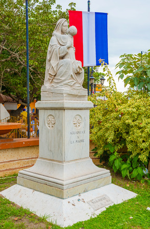 panama flag: Madonna with Jesus the sculpture in central square in Aguadulce in Panama.
