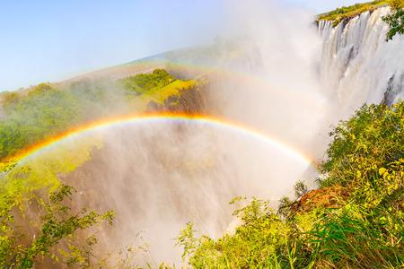 extreme terrain: Rainbow over the Victoria Falls in Zimbabwe