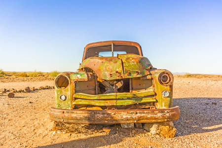 rusty car: Old rusty car in desert in southern Namibia. Stock Photo