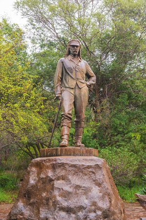 Victoria Falls Town, Zimbabwe-April 9, 2015: David Livingstone memorial at Victoria Falls, the bronze statue was erected in 1954 on the western bank of the falls.