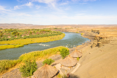 Scenic daylight view at the Orange river in Noordoewer in Namibia at Felix Unite Camp on May 2, 2015