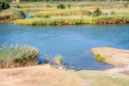 Scenic daylight view at the Orange river in Noordoewer in Namibia at Felix Unite Camp on May 1, 2015 版權商用圖片