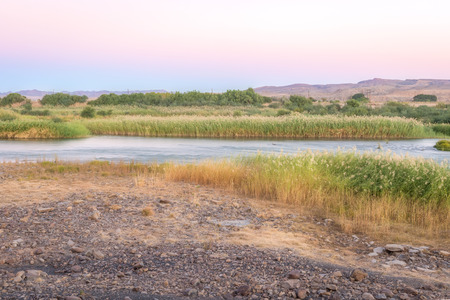 felix: Scenic sunset view at the Orange river in Noordoewer in Namibia at Felix Unite Camp on May 2, 2015 Stock Photo