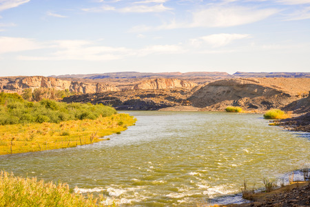 Scenic daylight view at the Orange river in Noordoewer in Namibia at Felix Unite Camp on May 1, 2015 Reklamní fotografie