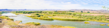 felix: Scenic daylight view at the Orange river in Noordoewer in Namibia at Felix Unite Camp on May 2, 2015