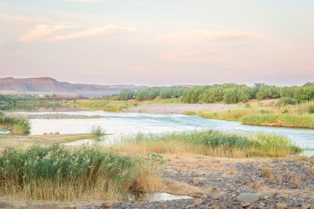 Scenic sunset view at the Orange river in Noordoewer in Namibia at Felix Unite Camp on May 1, 2015