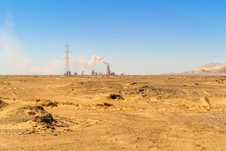 abu simbel: Desert landscape with factory on horizon near Abu Simbel in Egypt.