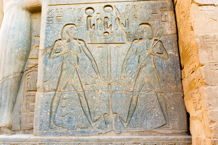 Stone carvings of pharaohIn in the Temple in Luxor, Egypt Editorial