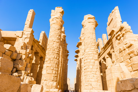 thebes: Luxor, Egypt - January 15, 2015: Tourists visiting ruins of the Karnak temple, Luxor, Egypt (Ancient Thebes with its Necropolis).