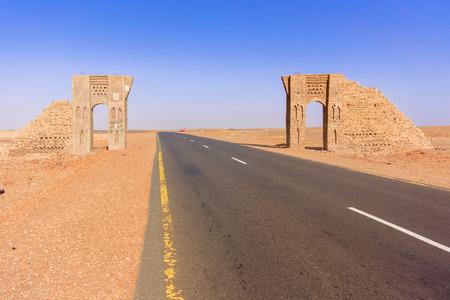 thru: Desert landscape and the road thru the Sahara desert in Sudan near Dongola in Sudan