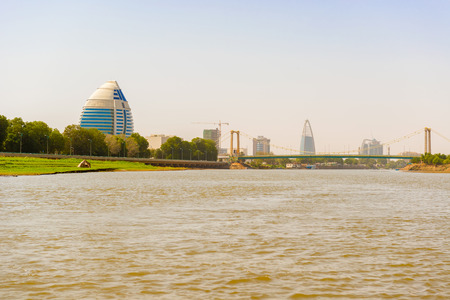 The city of Khartoum landscape. View of the modern buildings and the bridge over river Nile. Stock Photo