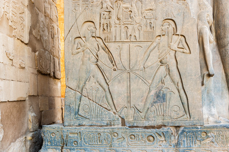 stone carvings: Stone carvings of pharaohIn in the Temple in Luxor, Egypt Stock Photo