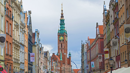 Gdansk, Poland - July 29, 2015: Historic Old Town houses with the town hall on Dluga street of Gdansk in Poland. Old historical buildings along the street are typical of Hanseatic towns in Europe. Redakční