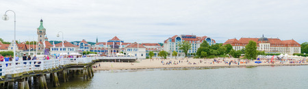 Sopot, Poland - July 21, 2015: View of the beach in Sopot, a major health-spa and tourist resort on the Polish Baltic Sea coast with two luxury hotels, old style Grand Hotel and modern Sheraton. Editorial