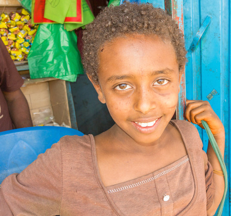 addis: Addis Zemen, Ethiopia - February 10, 2015: Close up picture of the girl in front of the store. Picture was taken in Addis Zemen in Ethiopia.