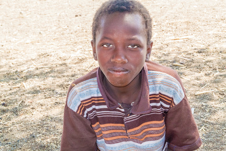 Sudan: El Hawata, Sudan - February 3, 2015: Young boy close up photo. Picture was taken in  El Hawata in Sudan.