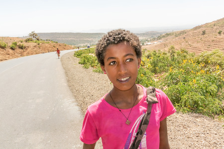 addis: Addis Zemen, Ethiopia - February 10, 2015: Close up picture of the child coming back from school. Picture was taken on the road near Addis Zemen in Ethiopia. Editorial