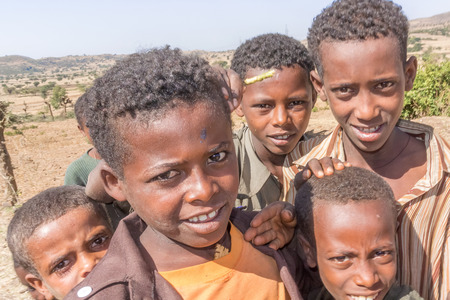 addis: Addis Zemen, Ethiopia - February 10, 2015: Close up picture of the children coming back from school. Picture was taken on the road near Addis Zemen in Ethiopia. Editorial