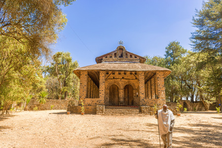 selassie: Gondar, Ethiopia - February 9, 2015: Priest in front of Christian church in Gondar, Ethiopia. It was named Debre Birhan Selassie, Trinity and Mountain of Light, and it is historic church.