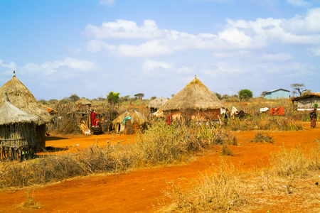 Moyale, Ethiopia - February 27, 2015: Farmland landscape and the people in front of the houses. Picture was taken from the road number 80 near Moyale in Ethiopia.
