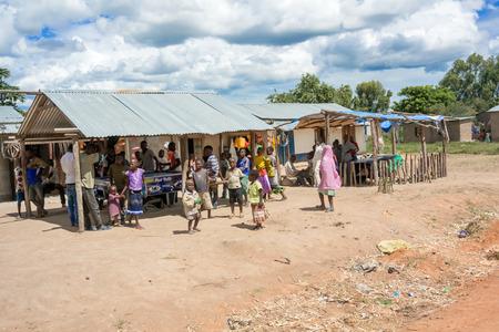 Kirumbi, Tanzania - March 17, 2015: People hanging around stores in small village in Kirumbi, Tanzania