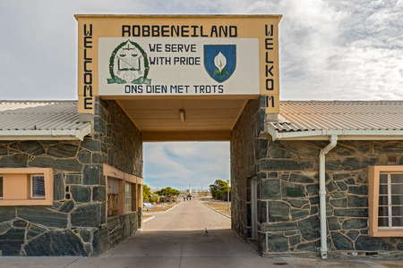 robben island: Cape Town, South Africa - May 14, 2015: People walking into Robben Island Prison where Nelson Mandela was imprisoned, now a museum, Cape Town, South Africa as viewed at the entry gate.