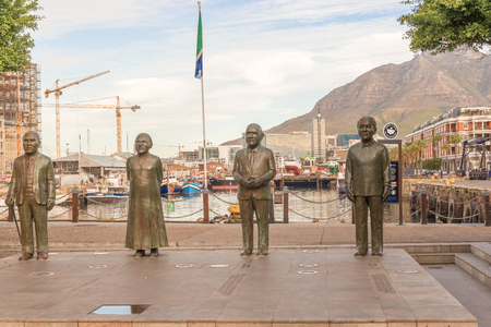 nobel: Cape Town, South Africa - May 14, 2015: Nobel Square with the four statues commemorating Nobel prize winners  in order from left  the late Chief Albert Luthuli, Archbishop Desmond Tutu, and former presidents FW de Klerk and Nelson Mandela