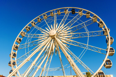 observation wheel: View at the Wheel of Excellence in Cape Town. It was  South Africas first observation wheel with 36 cabins and a famous tourist attraction.