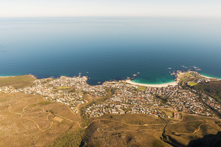 cape town: The town of Camps Bay as viewed from Table Mountain in Cape Town, South Africa. Photo shot in the afternoon sunlight; panoramic view. Stock Photo