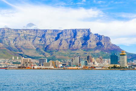 natural landmark: Cape Town, South Africa - May 12, 2015: View of  mostly office buildings in downtown Cape Town with The Table Mountain in the background. The downtown district is the financial heart of this city in South Africa. The Table Mountain is a natural landmark U Editorial