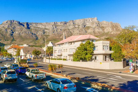 natural landmark: Cape Town, South Africa - May 11, 2015: View of  the traffic in Cape Town with The Table Mountain in the background. The downtown district is the financial heart of this city in South Africa. The Table Mountain is a natural landmark UNESCO world heritage  Editorial