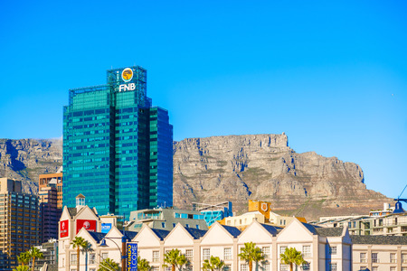 natural landmark: Cape Town, South Africa - May 11, 2015: View of  mostly office buildings in downtown Cape Town with The Table Mountain in the background. The downtown district is the financial heart of this city in South Africa. The Table Mountain is a natural landmark U Editorial