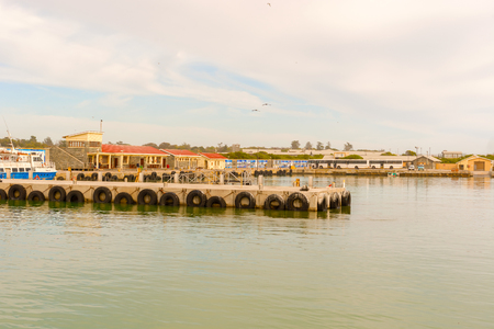 apartheid in south africa: View at the Robben Island dock, as seen from ferry boat, Cape Town, South Africa Stock Photo