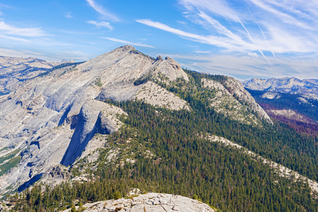 half dome: Panorama  of the  Sierra Nevada mountains and Yosemite National Park as viewed from the Half Dome in California, USA