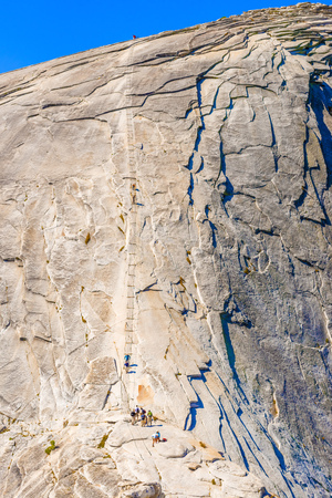 yosemite national park: Yosemite National Park, USA - September 24, 2015: People climbing Half Dome in Yosemite National Park. The Cables at the last 120m of Half Dome trail.