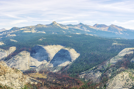 sierra nevada mountain range: Panorama  of the  Sierra Nevada mountains and Yosemite National Park as viewed from the Half Dome in California, USA