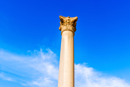 monolithic: Pompeys Pillar is a Roman triumphal column in Alexandria, Egypt, and the largest of its type constructed outside the imperial capitals of Rome and Constantinople. It is one of the largest monolithic columns ever erected. Stock Photo