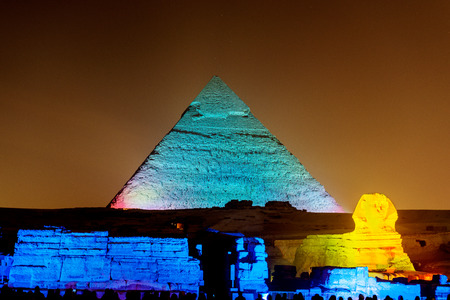 light show: Landscape view at the  Pyramids of Giza at night during light and sound show. Stock Photo