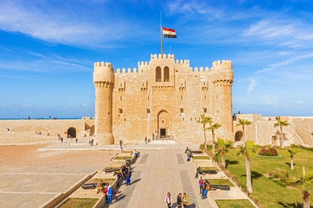 egypt flag: Alexandria, Egypt - January 2, 2015: Tourists in front of main entrance to Citadel of Qaitbay fortress, Alexandria, Egypt Editorial