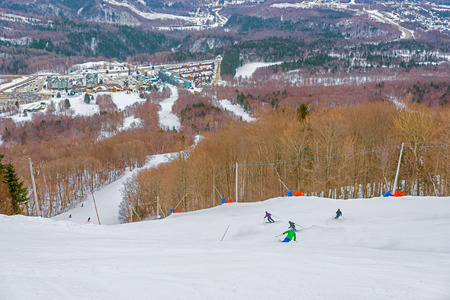 downhill: People skiing downhill in Mont Sainte Anne.