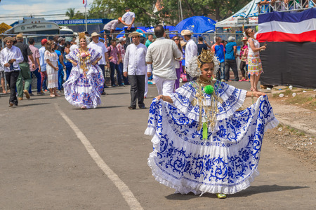 Los Santos, Panama - November 10, 2015: Girls in traditionasl dress in the parade in La Villa. Festival and parade in La Villa commemorates La Grita de la Independencia. Held every November 10, this festival reenacts the historic event and attracts dignit