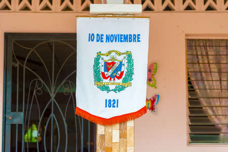 bandera panama: Los Santos, Panama - November 10, 2015: Flag on the street in La Villa. Festival and parade in La Villa commemorates La Grita de la Independencia. Held every November 10, this festival reenacts the historic event and attracts dignitaries from around Panam