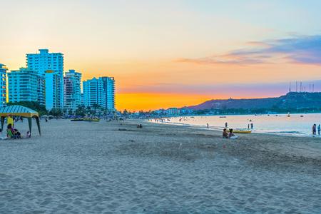 Salinas, Ecuador - April 14, 2016: People enjoying the sunset over the Playa de Chipipe in Salinas, Ecuador