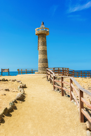 local landmark: Salinas, Ecuador - April 14, 2016: The lighthouse at La Chocolatera, the point of land that sticks furthest out into the Pacific Ocean from Ecuador. Editorial