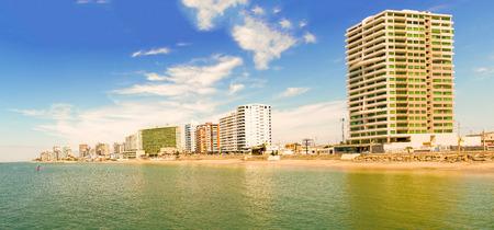 Salinas, Ecuador - April13, 2016: Panoramic view at the modern buildings facing the beach in Salinas, Ecuador.