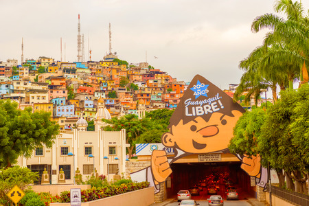 guayaquil: Guayaquil, Ecuador - April 15, 2016: Panoramic view at the cell phone towers and colorful houses of Guayaquils Cerro Santa Ana neighborhood.