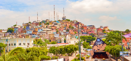 guayaquil: Guayaquil, Ecuador - April 16, 2016: Panoramic view at the cell phone towers and colorful houses of Guayaquils Cerro Santa Ana neighborhood.