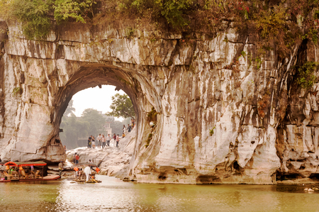 30 s: Guilin, China - September 30, 2008: Tourists entering the round opening that would be under the elephant�s trunk is known as Water Moon Cave because at night the reflection of the moon can be seen through the arch and it looks as if it is under the Editorial